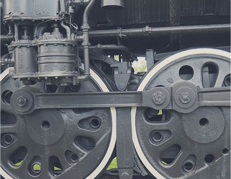 The wheels of a locomotive